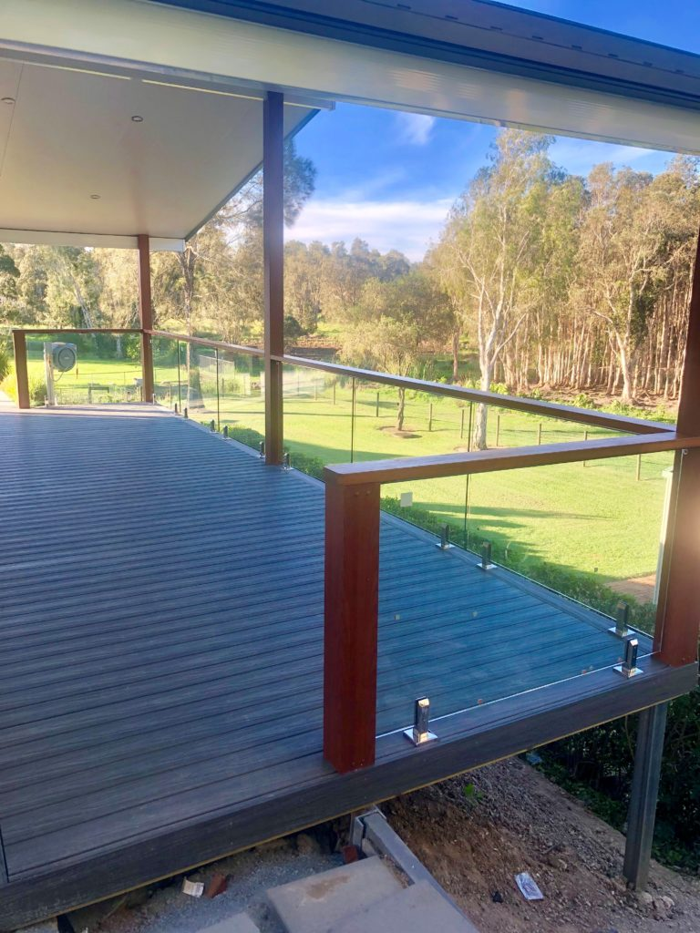 Gill Balustrade - deck facing the yard full of trees